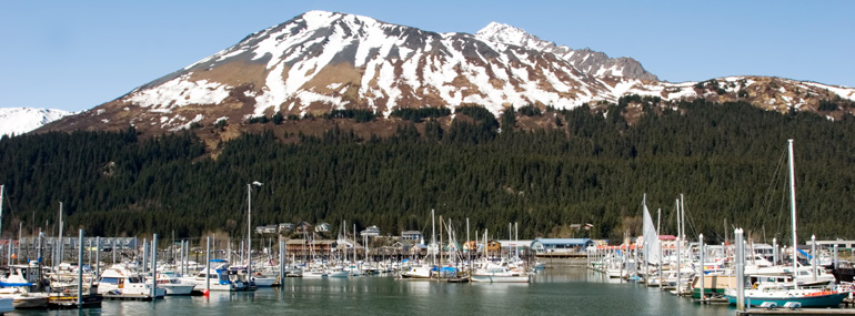 Which of these Alaskan port cities is accessible by car?