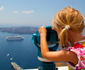 Girl looking at ships in Santorini