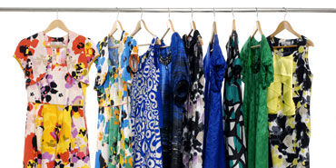Hanging dresses in a closet