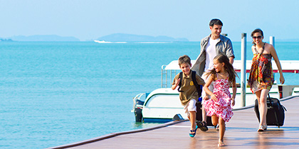 family on dock boarding cruise ship