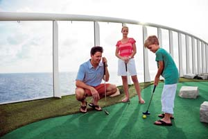family playing mini golf on cruise ship