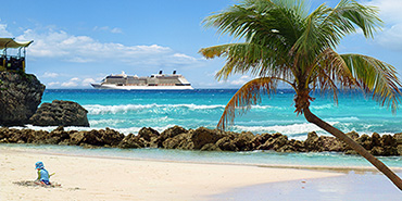 Ship cruising past a Caribbean beach
