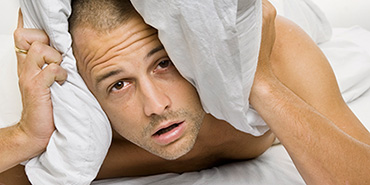 Man in cabin unable to sleep