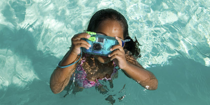 girl with waterproof camera in pool