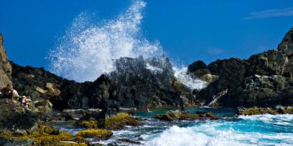 waves crashing in aruba natural pool