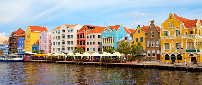 Head south to the Caribbean for some sun and sand. This former Dutch colony is known for the colorful architecture along its harbor.