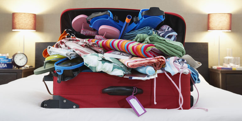suitcase overflowing cruise