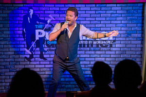 Comic on stage on Carnival Sunshine