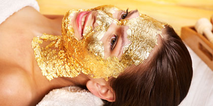 woman spa gold facial mask