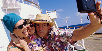 Family taking self-portrait on cruise